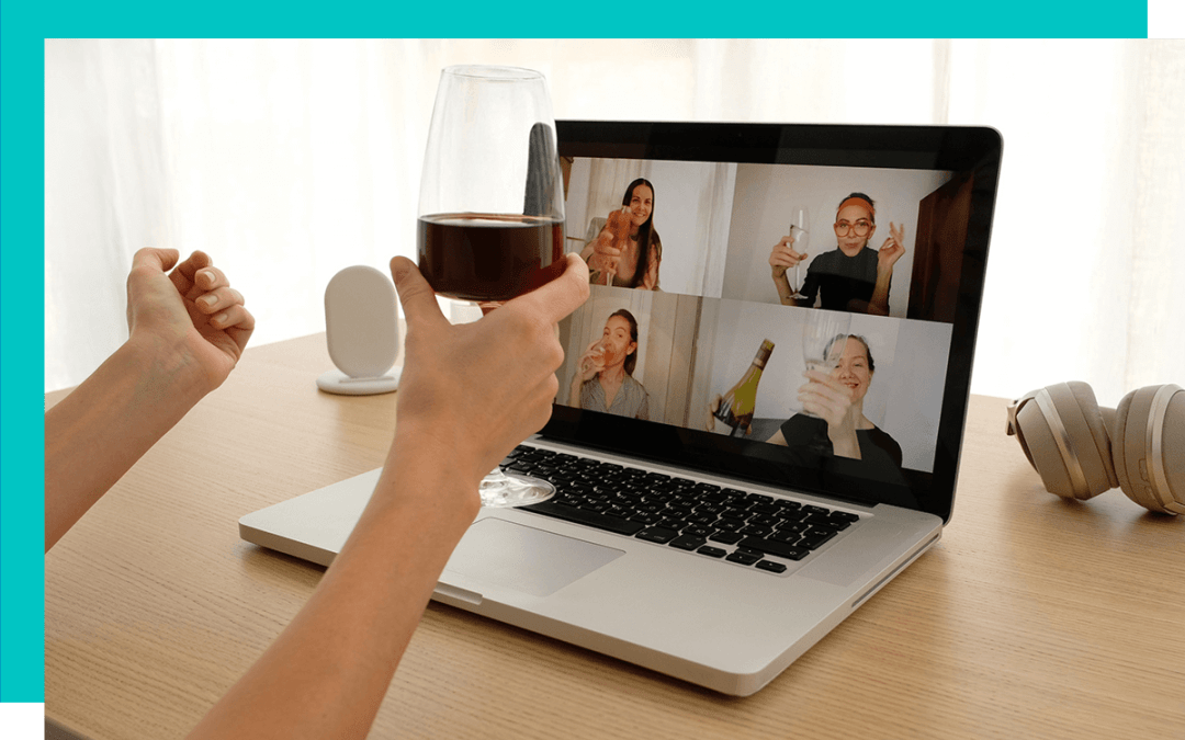 person drinking wine with colleagues over a video call